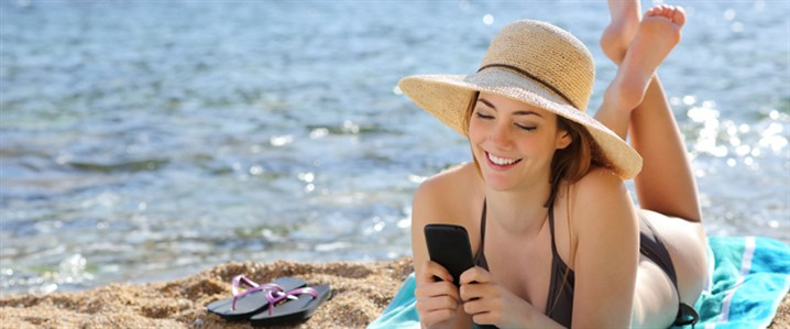 Using Phone On Beach