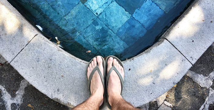 Feet by poolside